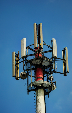 A  stock photography of telecommunication tower with blue sky in the background Stock Photo