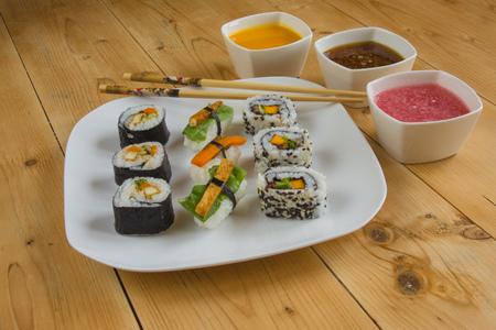Vegan sushi on plate and chopsticks