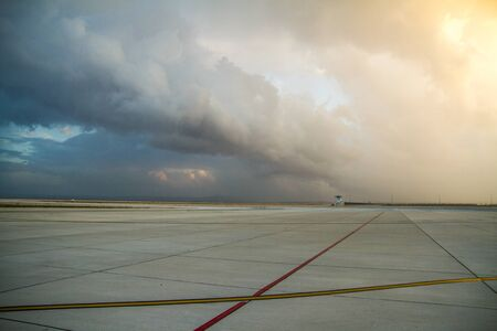 Empty airport with awesome sky - Stock image