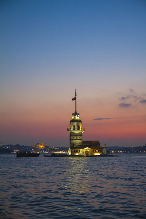 maiden: Maiden tower at sunset with Istanbul cityscape. Stock Photo