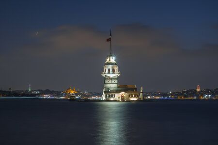 maiden: Maiden tower at night with Istanbul cityscape.