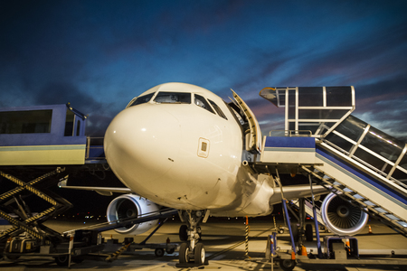 Commercial airplane and the ground services at the airport. Stock Photo