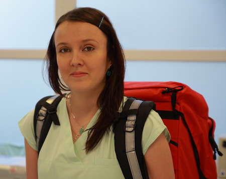 Great: Nurse with great  medical backpack in ICU Stock Photo