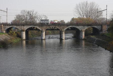 diesel train: The Universal diesel train on viaduct on river in city Brno in Europe