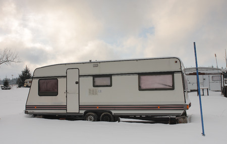 covered in snow: camper covered snow in winter