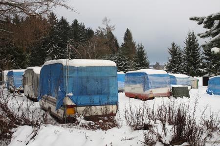campers covered by  snow in winter Stock Photo