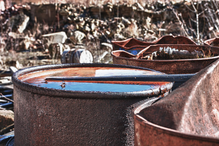 judgement day: Group of old, rusty barrels with toxic chemical  waste. Photo was taken on place, where textile factory was wrong  demolished. Hdr photo. Stock Photo