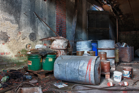 judgement day: Group of old, rusty barrels with toxic chemical  waste. Photo was taken on place, where textile factory was wrong  demolished. Stock Photo