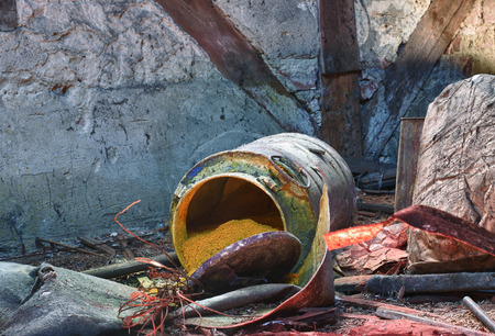 judgement day: Old, rusty barrel with toxic chemical  waste. Photo was taken on place, where textile factory was wrong  demolished.