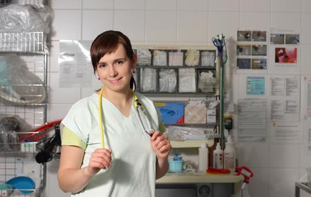 icu: Portrait female nurse in ICU in the green uniform.