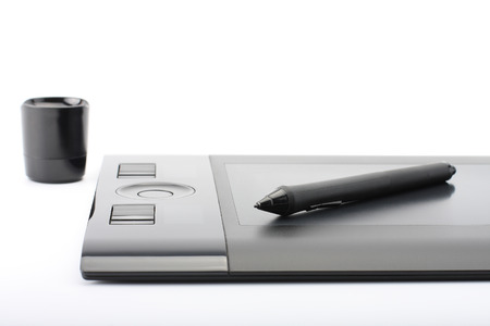 inputting: A close-up of  pen on graphic tablet on white background