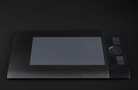 inputting: graphic tablet  on black background Stock Photo