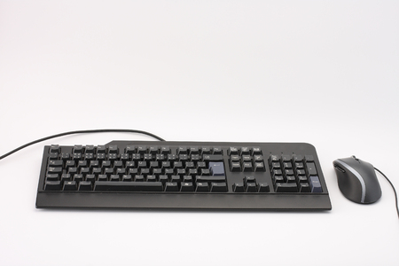Keyboard and mouse on white background.