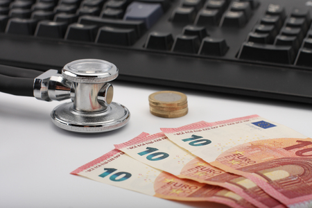 doctors tool: Stethoscope,money, keyboard on white, medical concept. Stock Photo
