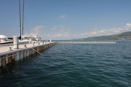 motor boats: Pier for motor boats and sailboats in harbor in Trieste, Italy