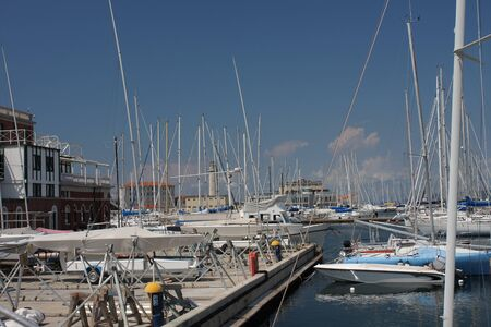motor boats: Motor boats and sailboats in harbor in Trieste, Italy on a summer day