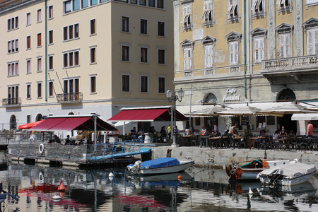 trieste: TRIESTE, ITALY - AUGUST 18, 2015 :  Restaurant in The Grand Canal on August 18, 2015 in Trieste on Italy. Trieste is a popular tourist town in Italy.