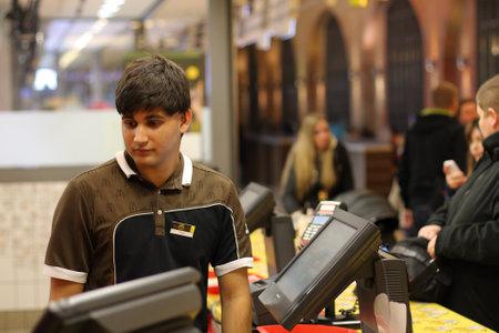 man s: BRNO,CZECH REPUBLIC-NOVEMBER 29,2015:Young man sales  in November 29,2015 in McDonald´s restaurant in shopping center  Vankovka in Brno in Czech Republic.