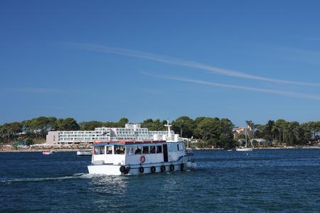 'saint nicholas': Tourist boat arrives to tourist center on Saint Nicholas island, near of city Porec in Croatia