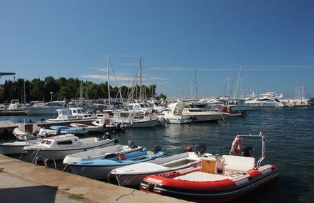 motor boats: Motor boats and sailboats in harbor in Porec,Croatia  on a summer day