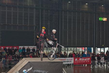 stunt: BRNO, CZECH REPUBLIC-MARCH 4,2016: Stunts riding bikes during stunt show on International Fair for Motorcycles  on March 4,2016 in Brno in Czech Republic Editorial
