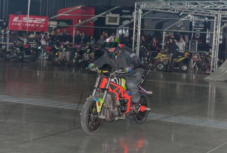 BRNO, CZECH REPUBLIC-MARCH 4,2016: Stuntman riding a motorcycle during stunt show on International Fair for Motorcycles  on March 4,2016 in Brno in Czech Republic