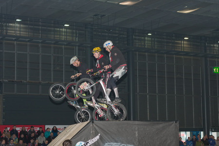 stunt: BRNO, CZECH REPUBLIC-MARCH 4,2016: Stuntmen riding a bikes during stunt show on International Fair for Motorcycles  on March 4,2016 in Brno in Czech Republic