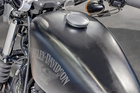sportster: BRNO, CZECH REPUBLIC-MARCH 4,2016: Close up  fuel tank of motorcycle Harley Davidson Sportster Iron 883  on International Fair for Motorcycles on March 4,2016 in Brno in Czech Republic