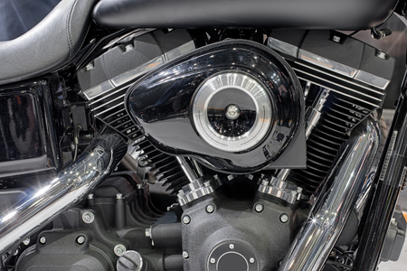 twin engine: Detail of air cooled twin engine of motorcycle.