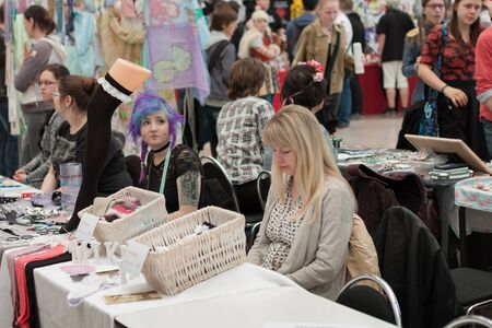 saleswomen: BRNO, CZECH REPUBLIC - APRIL 30, 2016: Two saleswomen at markets with clothing accessories  at Animefest, anime convention on April 30, 2016 Brno, Czech Republic