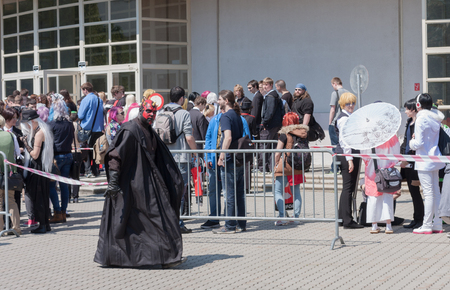 maul: BRNO, CZECH REPUBLIC - APRIL 30, 2016: Cosplayer dressed as character Darth Maul from Star Wars walks around visitors  queue at Animefest, anime convention on April 30, 2016 Brno, Czech Republic