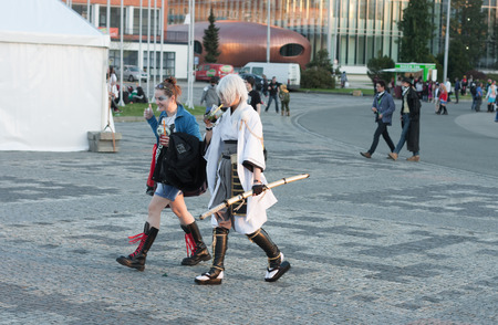 czech women: BRNO, CZECH REPUBLIC - APRIL 30, 2016: Visitors walking and drinking your drink at Animefest, anime convention on April 30, 2016 Brno, Czech Republic