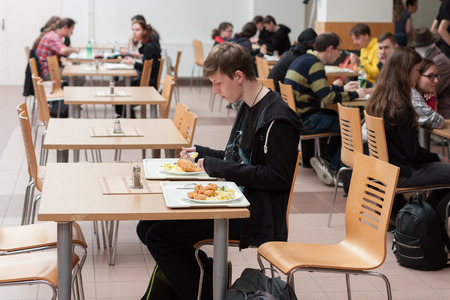anime young: BRNO, CZECH REPUBLIC - APRIL 30, 2016: Young people having lunch in the restaurant  at Animefest, anime and manga convention on April 30, 2016 Brno in the Czech Republic