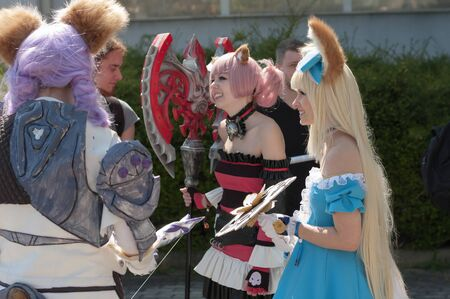 tera: BRNO, CZECH REPUBLIC - APRIL 30, 2016: Three cosplayers dressed as the character Elin from game Tera online  at Animefest, anime and manga convention on April 30, 2016 Brno in the Czech Republic