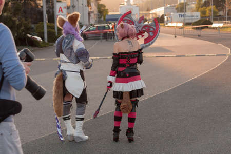 tera: BRNO, CZECH REPUBLIC - APRIL 30, 2016: Two cosplayers dressed as the character Elin from game Tera online pose at Animefest, anime and manga convention on April 30, 2016 Brno in the Czech Republic Editorial