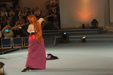 necromancer: BRNO, CZECH REPUBLIC - APRIL 30, 2016:Cosplayer dressed as character Sorceress from game Dragon�s Crown during cosplay contest  at Animefest, anime convention on April 30, 2016 Brno, Czech Republic Editorial