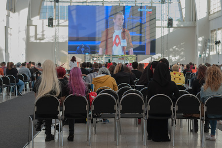 projection screen: BRNO, CZECH REPUBLIC - APRIL 30, 2016: Visitors sitting and watching streaming on projection screen at  Animefest  on April 30, 2016 Brno, Czech Republic