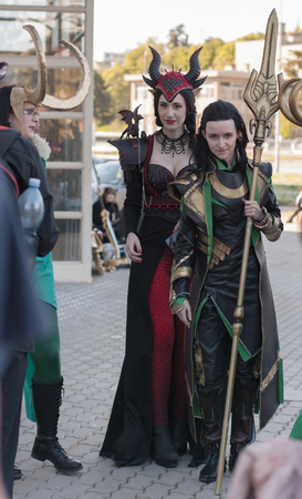 breast comic: BRNO, CZECH REPUBLIC - APRIL 30, 2016: Two cosplayers dressed as characters Ruby Dragon and Loki pose at Animefest, anime and manga convention on April 30, 2016 Brno in the Czech Republic