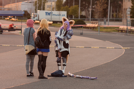 tera: BRNO, CZECH REPUBLIC - APRIL 30, 2016:  Cosplayer dressed as the character Elin from game Tera online talks with friends  at Animefest  on April 30, 2016 Brno in the Czech Republic Editorial