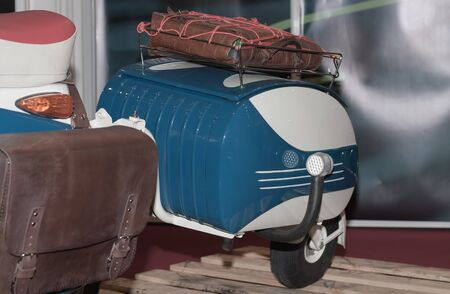 additional: Additional luggage on electric scooter, indoor photo.