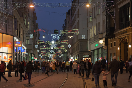 advent time: Brno, Czech Republic-December 5.2016: Walking people at Masaryk street at Advent time on December 5, 2016 in Brno, Czech Republic