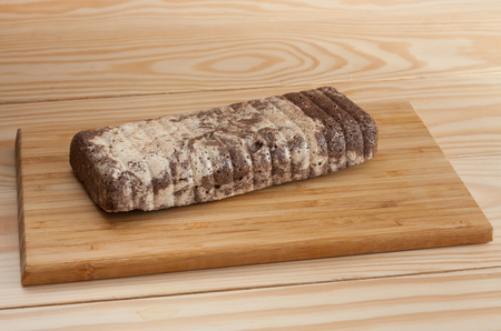 sunflower seeds: Greek sesame halva with cocoa on bamboo cutting board on wooden table Stock Photo