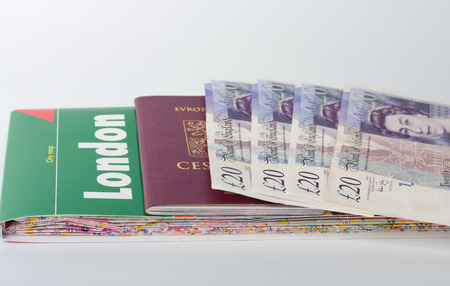 gb pound: Map of London,passport and british pounds, equipment before traveling. Stock Photo