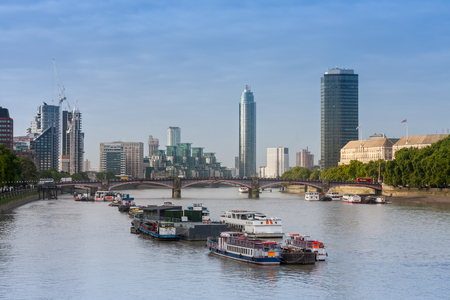 City cruise ships on the river Thames, on background Lambert  Bridge and London Towers  in the morning, London, England.  Banco de Imagens