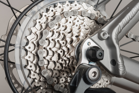 Close up 9-speed cassette on rear wheel of bike, studio photo