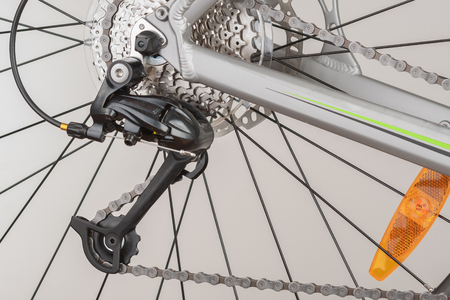 Close up of 9-speed cassette and rear derailleur on rear wheel of bike,  studio photo.  Stock Photo