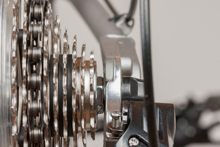 Close up 9-speed cassette on rear wheel of bike, studio photo.