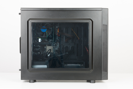 Midi tower computer case with transparent acryl side panel on white background