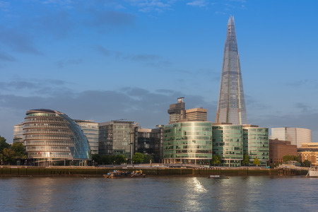 THE QUEEN´S WALK,LONDON-SEPTEMBER 7,2017: City Hall, buildings called More London and skyscraper The Shard on the south bank of the river Thames in London in the morning, view from Tower bridge.