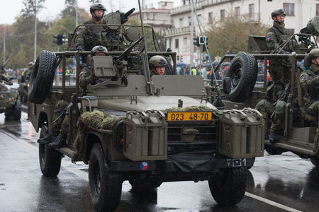 European street, Prague-October 28, 2018: Soldiers of Czech Army are riding Land Rover Defender cars  on military parade on October 28, 2018 in Prague, Czech Republic
